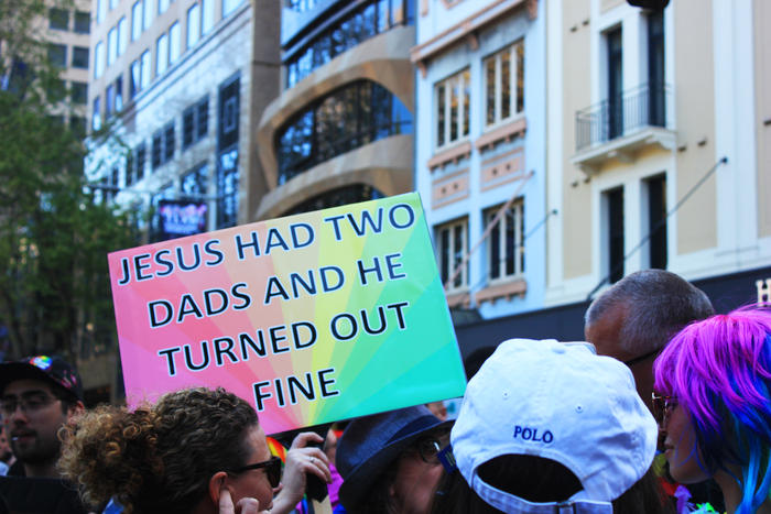 'Jesus had two dads' sign at Sydney Marriage Equality rally on September 10th, 2017. (Photo: Chloe Sargeant / SBS)