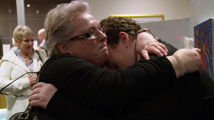 Michelle and Jess hug in an episode of Struggle Street
