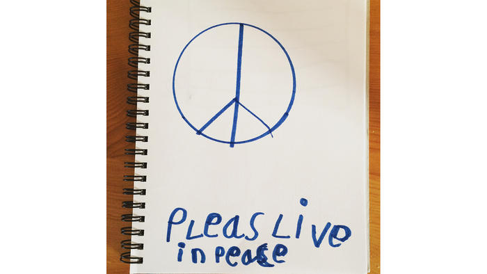 Child's hand-drawn peace sign