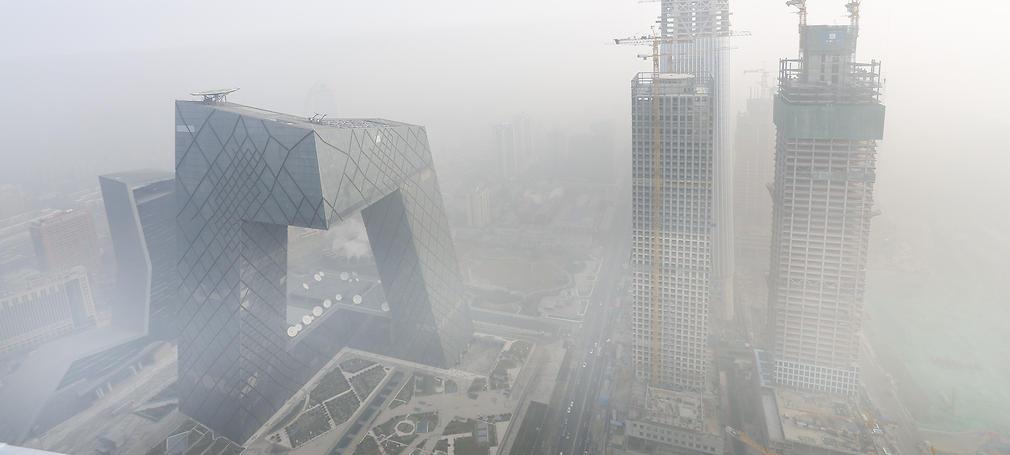 CCTV's iconic headquarters (left) through Beijing smog.