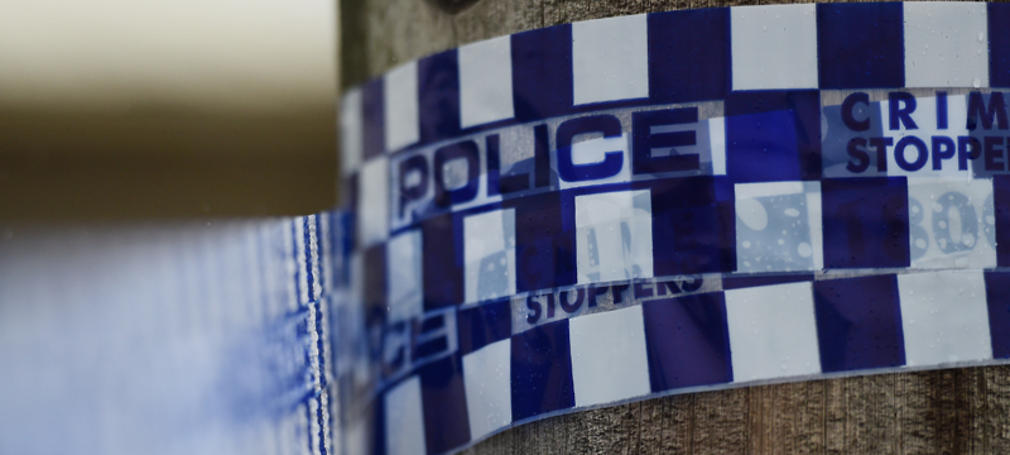 Police tape is seen at a home