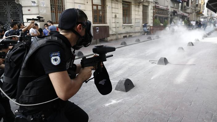 Riot police fire rubber bullets at protestors