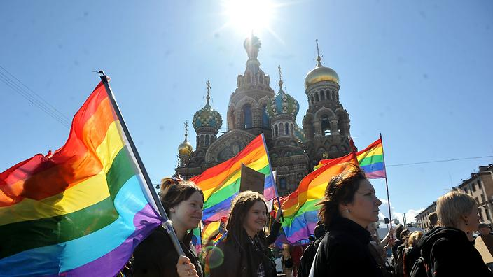 Gay rights activists march in Russia's second city of St. Petersburg May 1, 2013, during their rally against a controversial law in the city that activists see as violating gay rights