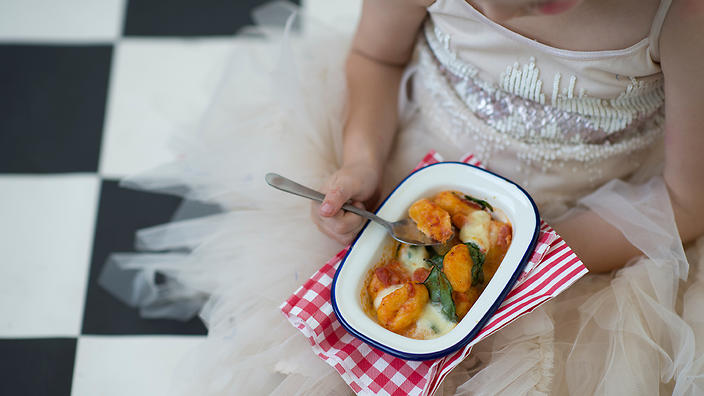 Baked pumpkin gnocchi combines pumpkin, tomatoes and spinach for a ...