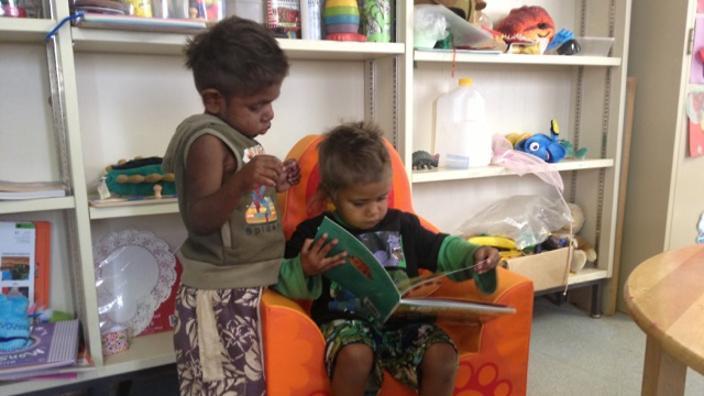 Kids from Australia's remotest community, Tjuntjuntjara, enjoy a book delivery from the ILF.