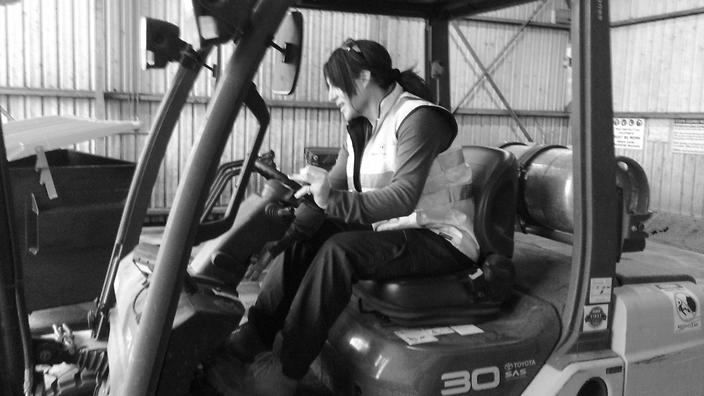 Holly Conroy driving a forklift.