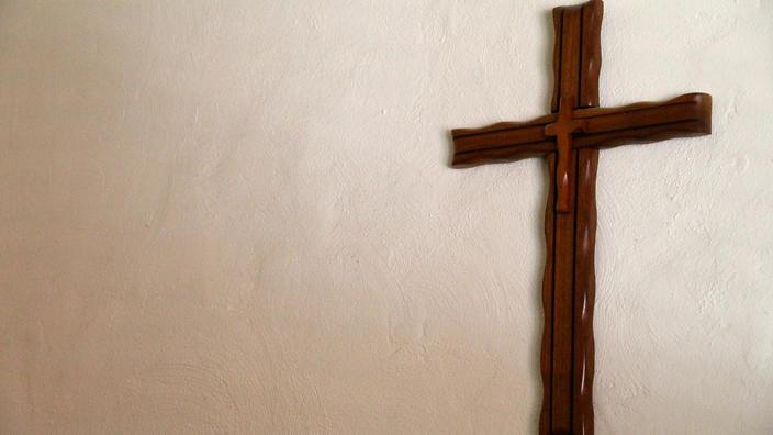 Handmade Wooden Cross Hanging on a Wall