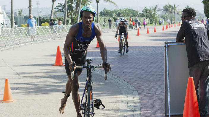 Attackers use blunt saw to cut into triathlete's legs, causing severe injuries