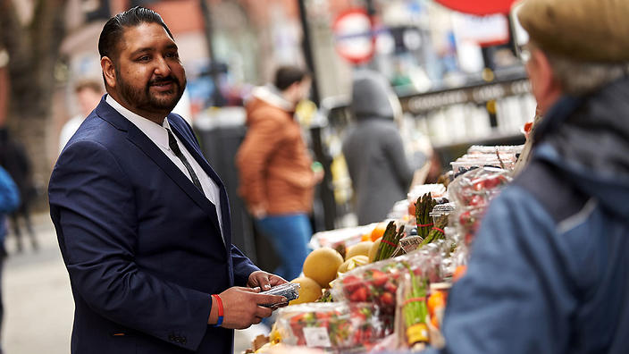 Man buying fruit