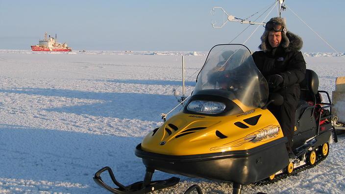 arctic scientist in vehicle
