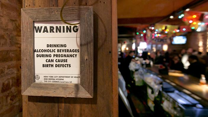 Alcoholic woman signs