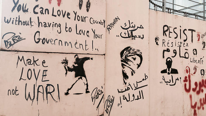 Anti-war and anti-government graffiti scrawled on a construction site in downtown Beirut.