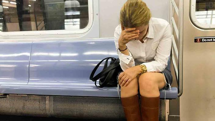 Stressed professional woman sitting on a train
