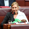 Australian Greens Senator Larissa Waters breastfeeds her eight-week-old baby Alia Joy during a division in the Senate chamber.