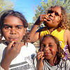 Indigenous childrean eat native foods such as honey ants near Alice Springs as a part of the Children's Ground early education program.