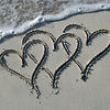 Three Hearts in the Sand with Wave