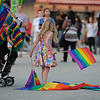 Child with rainbow flags at Pride