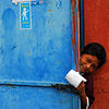 A young boy uses an outdoor latrine