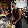 This photo taken on March 13, 2017 shows homeless man Lanz Priestley preparing food in a makeshift shelter for the homeless in Sydney.