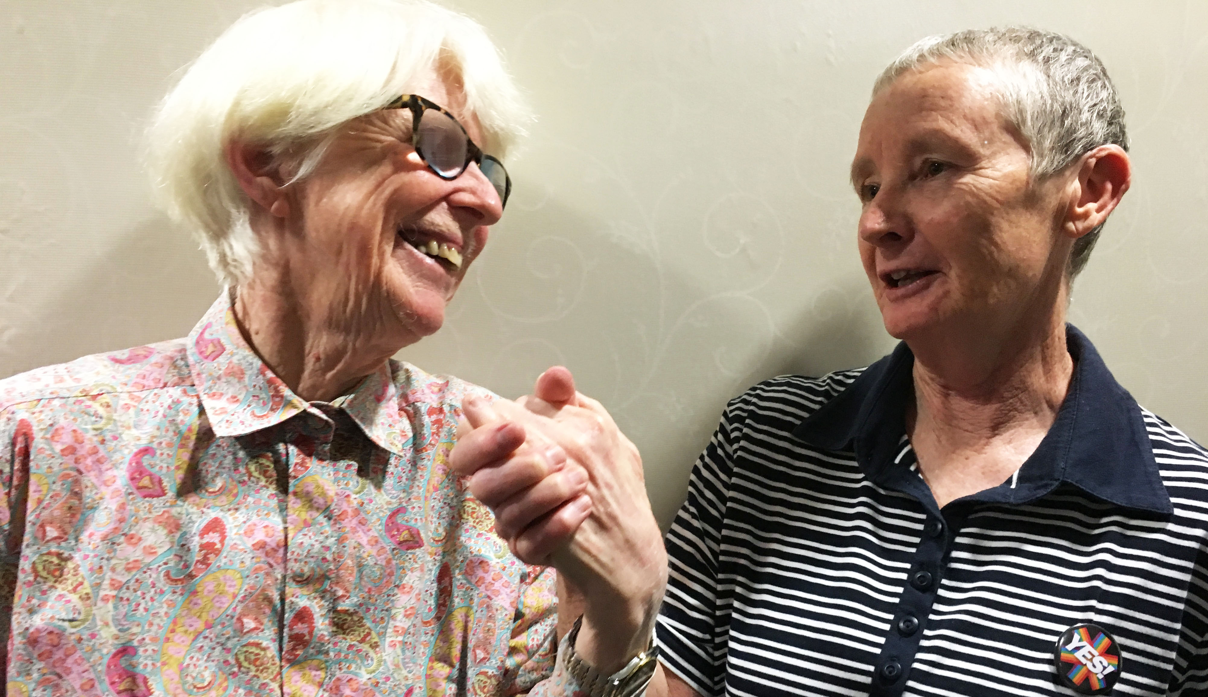 Elderly lesbians are going to hold hands on a tram this