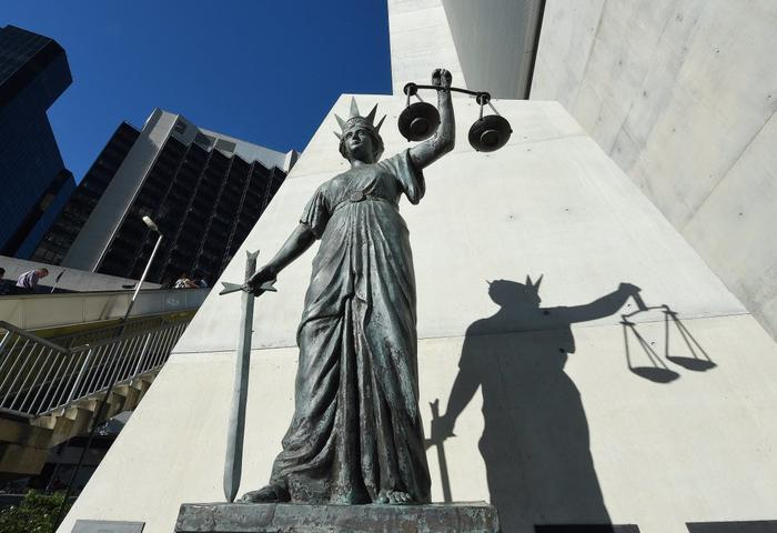 A statue of Themis, the Greek God of Justice stands outside the Supreme Court in Brisbane, Thursday, Oct. 20, 2016.
