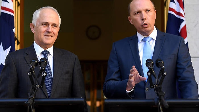 Immigration Minister Peter Dutton (R) has defended the decision to scrap the 457 visa program.
