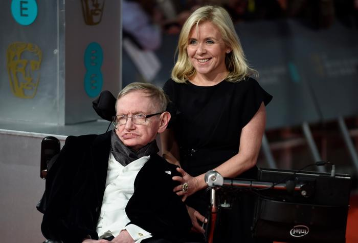 British scientist Stephen Hawking (L) and his daughter Lucy Hawking (R) arrive on the red carpet for the 2015 British Academy Film Awards