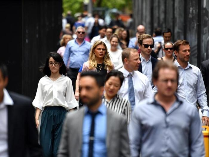 Office workers are seen at lunch break at Martin Place in Sydney