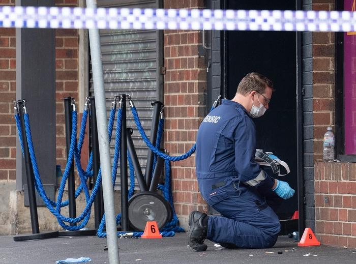 Victoria Police at the scene of a multiple shooting outside Love Machine nightclub in Prahran, Melbourne, Sunday, April 14
