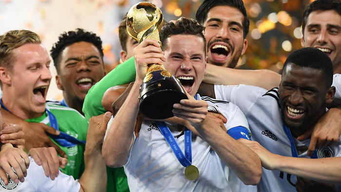 Germany's midfielder Julian Draxler lifts the trophy after winning the 2017 Confederations Cup