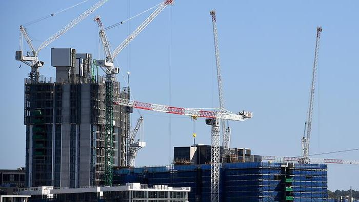An unexpected leap in apartment approvals intensifies risks in the housing market, analysts warn. (AAP)