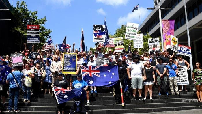 Protesters assemble for a group photograph following a Reclaim Australia rally in Sydney on Sunday, Jan. 29, 2017. (AAP Image/Paul Miller) NO ARCHIVING