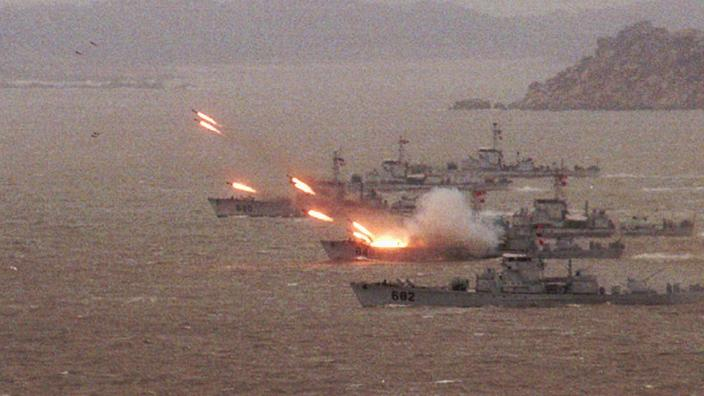 Picture from March 25, 1996, showing warships launching missiles to clear a beach head during a mock attack on Taiwan.